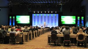 Picture of Audience listening to a lecture presented in a corporate seminar hosted by Event Management Company name Kiyoh