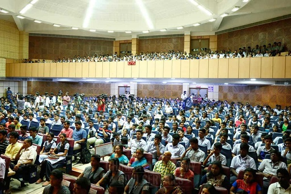 Group Of Students And Their Parents Gathering In A Hall For Career Guidence program.